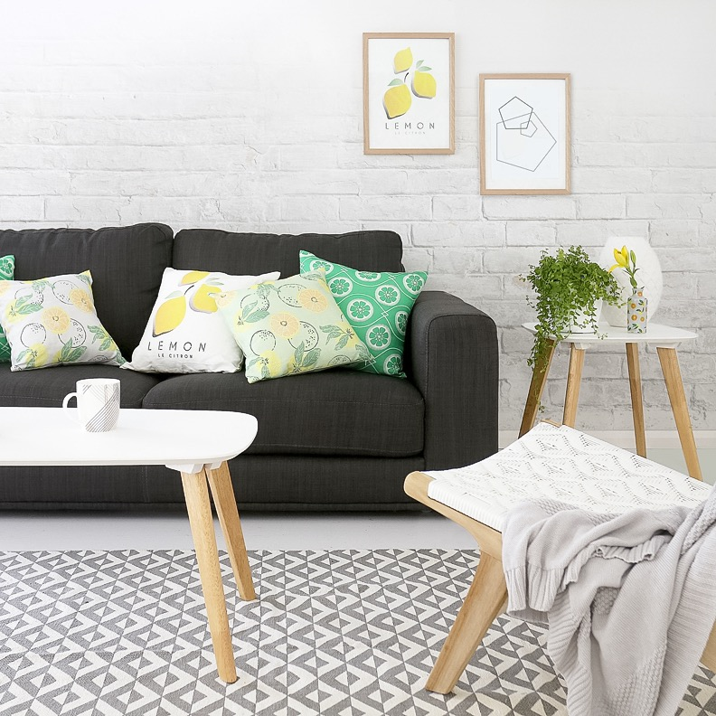 Millie Archer Citrus homewares cushion in background in living room