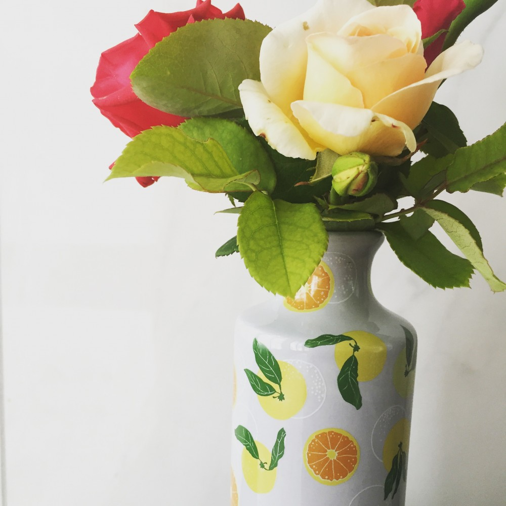 Millie Archer Citrus on blue vase with roses