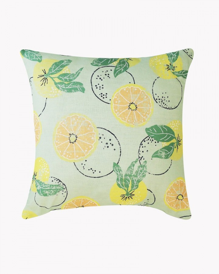 Citrus on green linen cushion